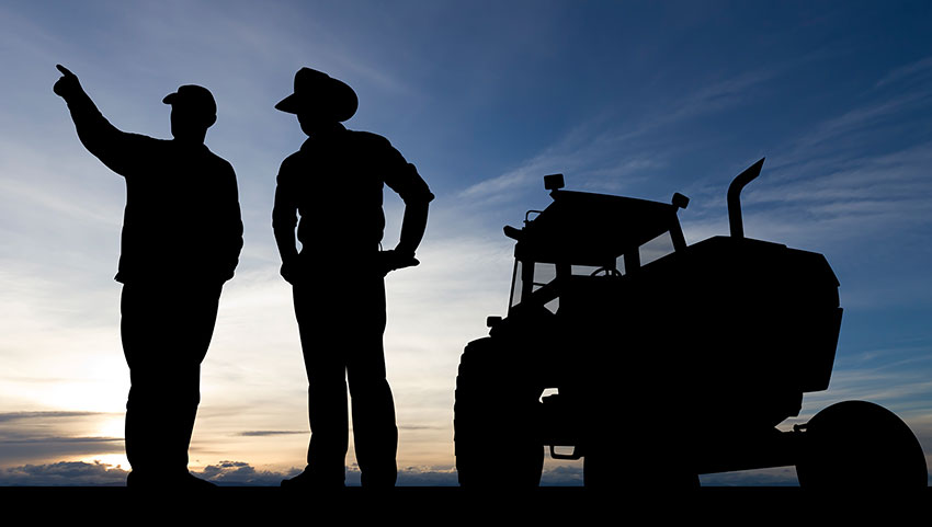 two-farmers-by-tractor-850.jpg