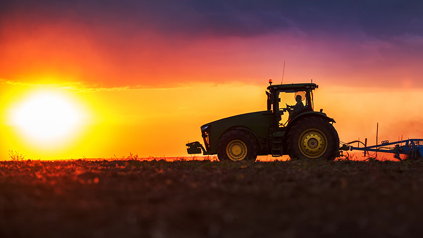 tractor-in-field-at-sunset-850