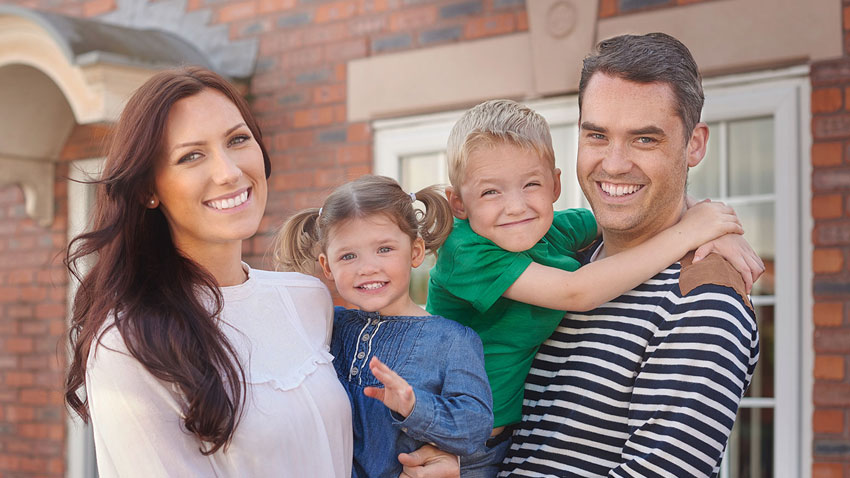 Family-in-Front-of-Home-SMALL
